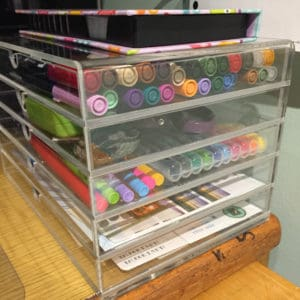 A set of acrylic drawers with Tombow Dual Brush Pens and Papermate Flair Bullet Journal supplies