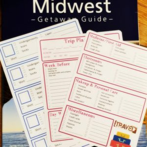 A picture of travel planning stickers with packing lists, trip information, and more