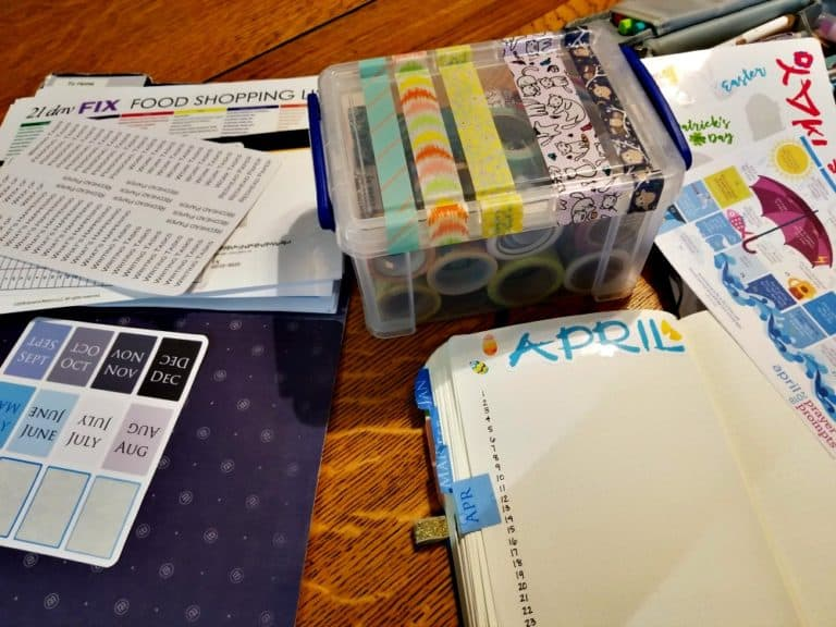 Planning process: A table spread with washi tape, stickers, and a Bullet Journal